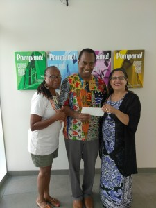 Carolyn Jones and Herman LeVern Jones of TheatreSouth Atlantareceive a check from Nancy Pena-Brink, President MJBF
